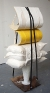 Cassie Raihl, PillPenders, 2010. Suspenders, Wood, plaster, glass vase, cardboard. 16 x 49 x 13 in.