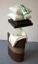 Cassie Raihl, WaterStack, 2010. Wood, plaster, vase, water, plastic, stuffing. 16 x 45 x 13 in.